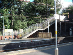 The stairs up from the platform for trams to Altrincham