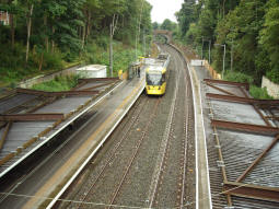 Looking down to the platforms as a tram being used for driver training passes heading to Bury