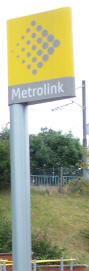 A Metrolink logo sign pictured at Besses o' th' Barn station